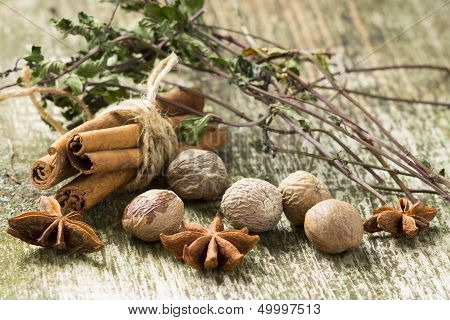 Spices And Dried Herbs On Old Wood Background