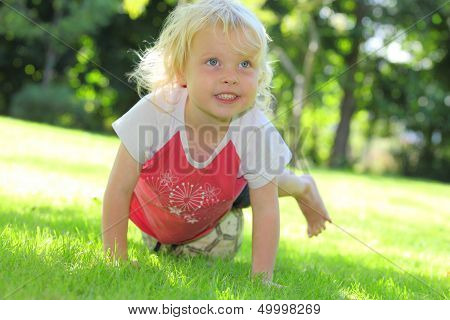 Happy young girl outdoors in the garden