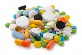 stock photo of antibiotics  - Pile of various colorful pills isolated on white - JPG