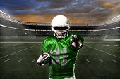 image of adults only  - Football Player with a green uniform celebrating with the fans - JPG