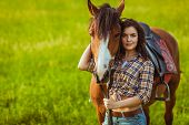picture of cowgirl  - brunette cowgirl woman posing with horse outdoors portrait - JPG