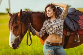 image of cowgirl  - brunette sexy cowgirl woman posing with horse outdoors portrait - JPG