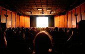 stock photo of watching movie  - public in cinema with white bright screen  - JPG