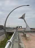 Curved art deco style street light framing the big dipper at blackpools pleasure beach