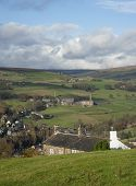 stock photo of edwardian  - An Edwardian farmhouse overlooking a Yorkshire Dales valley towards a small village - JPG