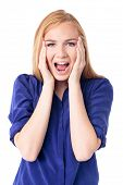 stock photo of shock awe  - Woman reacting in amazement and shock with her mouth open in awe and her hands clasping her cheeks isolated on white - JPG