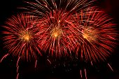 stock photo of guy fawks  - Bursts of Red and Orange Fireworks against a black sky - JPG