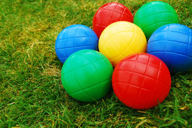 picture of crown green bowls  - Vibrant Multi coloured balls / boules on grass ** Note: Shallow depth of field - JPG