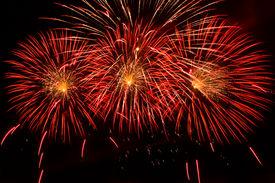 foto of guy fawks  - Bursts of Red and Orange Fireworks against a black sky - JPG