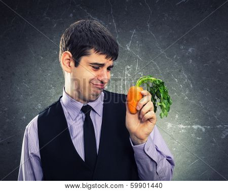 Small carrot in hand