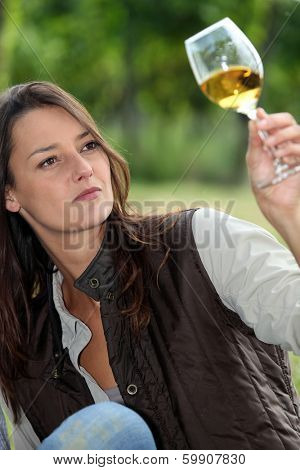 winemaker watching glass of wine