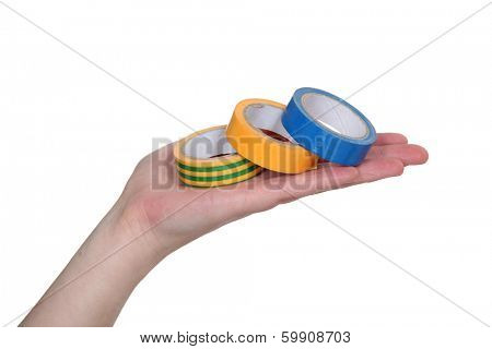 hand showing rolls of adhesive tape
