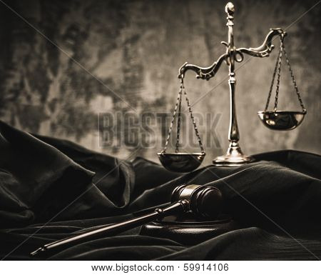 Scales and wooden hammer on judge's mantle