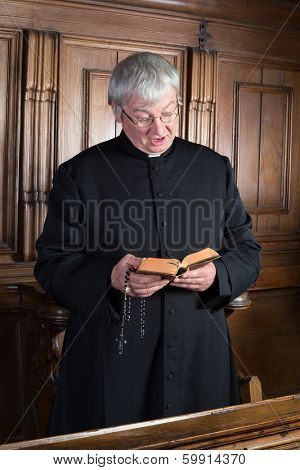 Vintage victor dressed in black cassock singing a hymn