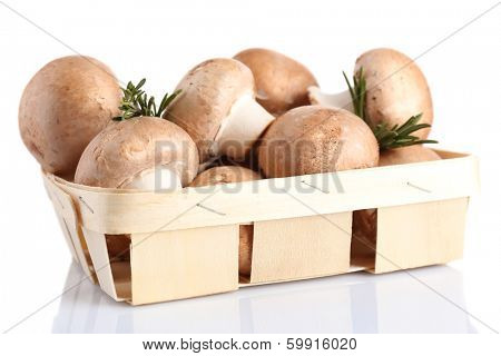 Fresh mushrooms in basket, isolated on white