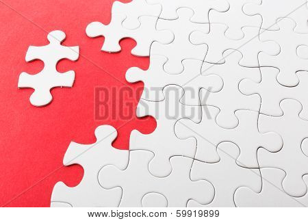 Incomplete puzzle with missing pieces