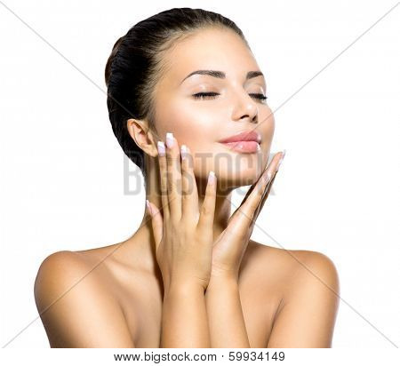 Beauty Spa Woman Portrait. Beautiful Girl Touching her Face. Perfect Fresh Skin. Pure Beauty Model Girl. Youth and Skin Care Concept. Pampering Skin. Health Care concept. Isolated on white background