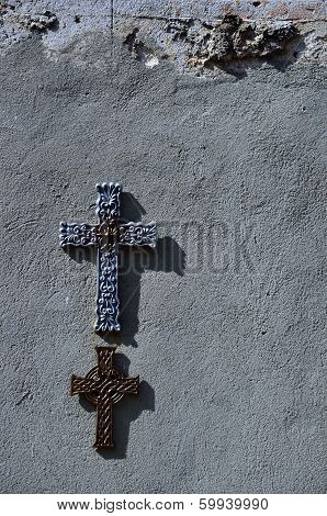 Two crossing on a stucco wall