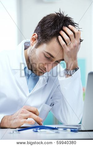 Doctor Working At His Desk
