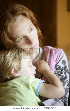 Baby Toddler Girl Sleeping In Mother Arms
