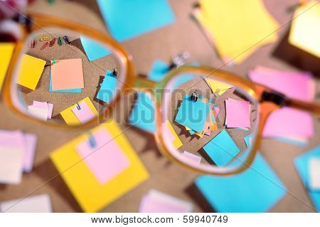 Blank post its seen through high diopter eyeglasses.