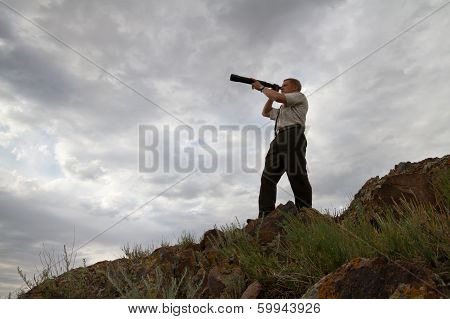 The Businessman Looks In A Telescope