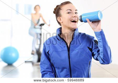 Portrait of a woman holding a blue bottle