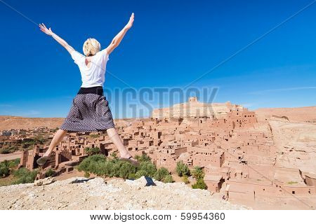 Traveler Jumpin In Front Of Ait Benhaddou, Morocco.