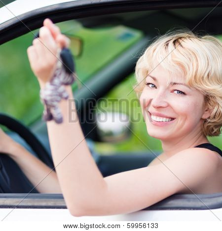 Lady, Driving Showing Car Keys Out The Window.