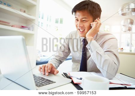 Asian Businessman Working From Home Using Mobile Phone