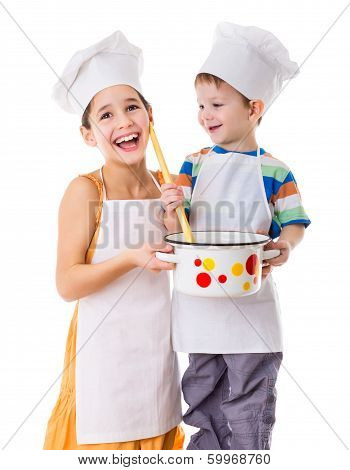 Two kids with pan and big ladle