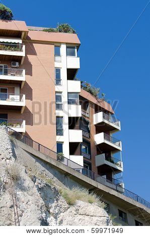 Urban Houses On The Mountain Cliff.