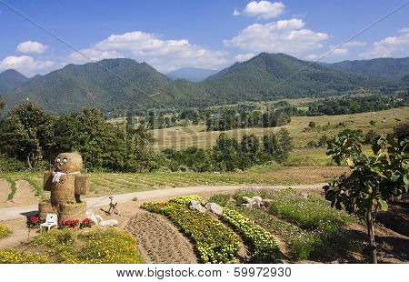 A View Of Fields And Mountains In The Village Of Pai