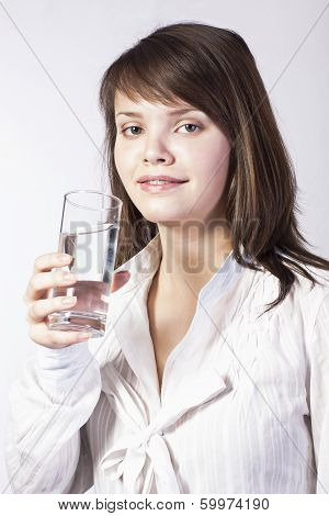Young Woman With Glass Of Water On A White