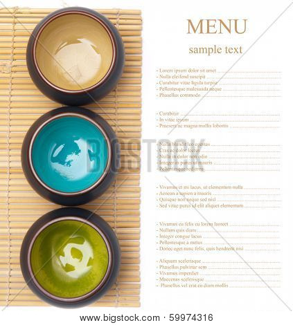 empty ceramic bowls on bamboo placemat with sample text