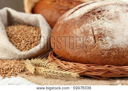 Rye bread with grains on sackcloth on table close up