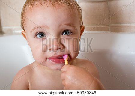 Baby boy brushing teeth