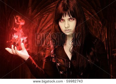 Spooky woman with fire in her hand
