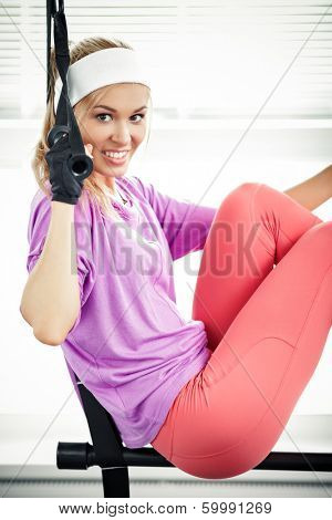 Young woman streching muscles functional training