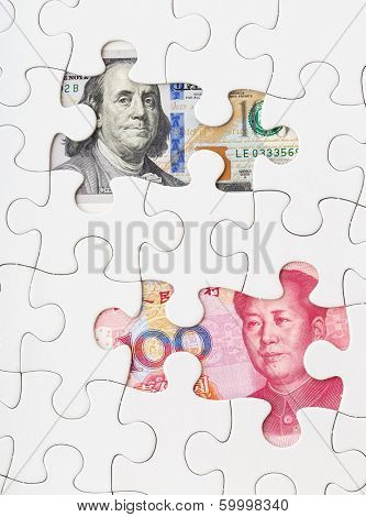 US dollar and chinese yuan with white puzzle
