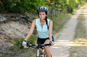 foto of bike path  - Woman mountain biking on countryside path recreation - JPG