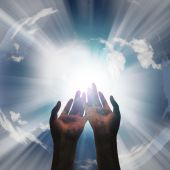 stock photo of praying hands  - Prayer like gesturing Hands reveal light with sky - JPG