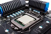 stock photo of processor socket  - Multiphase power system modern processor with heatsink and the CPU socket - JPG
