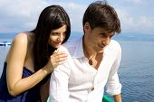stock photo of reunited  - Couple in vacation in Italy after fight get reunited on lake - JPG