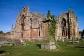 stock photo of embalming  - Melrose Abbey in the Scottish Borders is a beautiful and atmospheric red sandstone medieval ruin - JPG