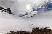 foto of taurus  - Snowy mountain pass and sky with clouds at evening - JPG