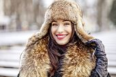 pic of ermine  - Woman in cold weather wearing real fur fashion clothes - JPG