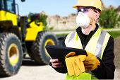 stock photo of dozer  - Contractor with Tablet and Bulldozer - JPG