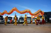 Team Of People Perform Dragon Dance
