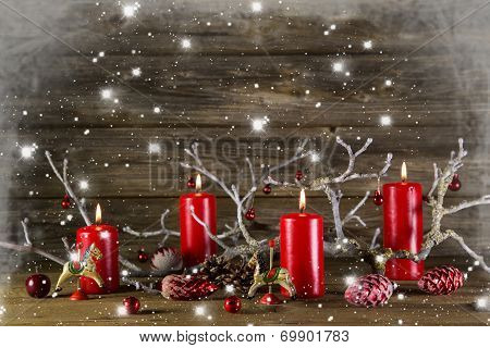 Xmas Decoration On Wooden Rustic Background: Four Red Burning Advent Candles.